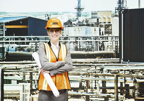 Smiling architect in oil refineryhttp://www.twodozendesign.info/i/1.png